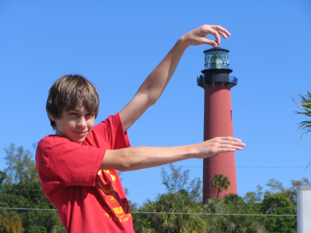 He's got the lighthouse in his hands! Kevin Brown, 14, of Jupiter, was waiting in the parking lot of the Jupiter Inlet Lighthouse and Museum, waiting for the rest of the Boy Scouts from Troop 132 of Palm Beach Gardens to arrive for the lighthouse tour. He got creative for dad Mitchell Brown's camera. Contributed