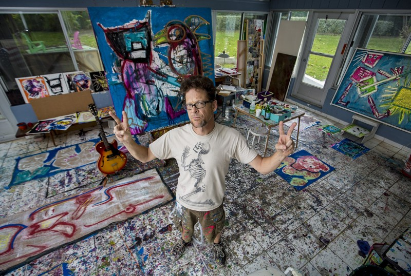 Former Metallica bassist Jason Newsted stands inside his art studio where he finished a few pieces the night before at his photo